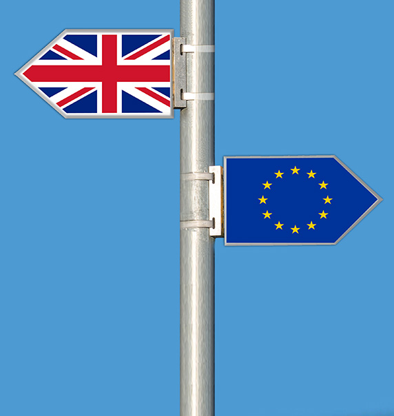British and EU flags on a post.