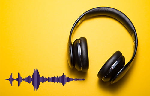 Headphones and audio wave on yellow background.